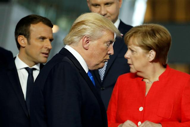 <p>President Donald Trump (C) walks past French President Emmanuel Macron (L) and German Chancellor Angela Merkel on his way to his spot for a family photo during the NATO summit at their new headquarters in Brussels, Belgium May 25, 2017. (Jonathan Ernst/Reuters) </p>