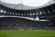 Players stand on the pitch applauding in a tribute to former player Jimmy Greaves before the English Premier League soccer match between Tottenham Hotspur and Chelsea at the Tottenham Hotspur Stadium in London, England, Sunday, Sep. 19, 2021. Greaves, one of England's greatest goal-scorers who was prolific for Tottenham, Chelsea and AC Milan has died. He was 81. Greaves was the all-time record scorer for Tottenham, which announced his death on Sunday. (AP Photo/Matt Dunham)