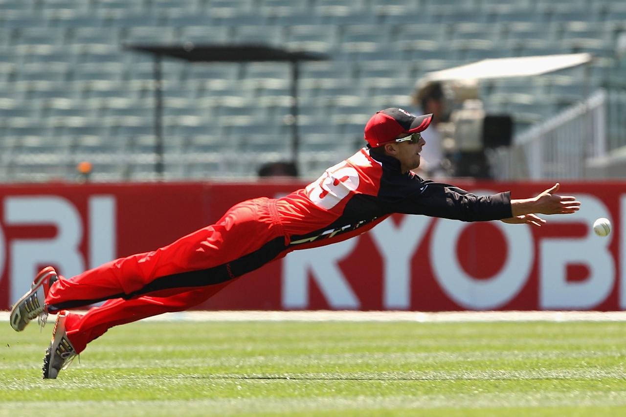 MELBOURNE, AUSTRALIA - NOVEMBER 28:  Alex Ross of the Redbacks dives for a catch unsuccessfully during the Ryobi One Day Cup match between the Victorian Bushrangers and the South Australian Redbacks at Melbourne Cricket Ground on November 28, 2012 in Melbourne, Australia.  (Photo by Robert Prezioso/Getty Images)