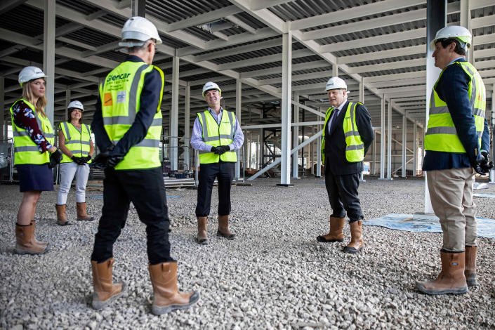 Image: Britain's Prime Minister Boris Johnson talks with scientists as he visits the construction site of the new dedicated Vaccines Manufacturing Innovation Centre near Didcot in central England in September. (Richard Pohle / AFP - Getty Images)