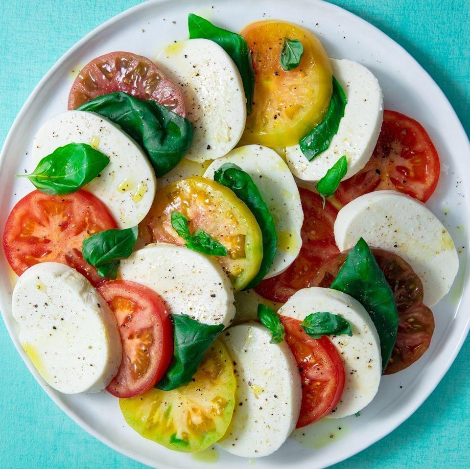 """<p><a href=""""https://www.delish.com/uk/cooking/recipes/a28827847/caprese-bites-recipe/"""" rel=""""nofollow noopener"""" target=""""_blank"""" data-ylk=""""slk:Caprese salad"""" class=""""link rapid-noclick-resp"""">Caprese salad</a> is the ultimate example of simple preparation with fresh ingredients making amazing food, not just to eat but look at. It is also the best way to show off any tomatoes you saw at the farmer's market or have in your back garden.</p><p>Get the <a href=""""https://www.delish.com/uk/cooking/recipes/a32998471/easy-caprese-salad-recipe/"""" rel=""""nofollow noopener"""" target=""""_blank"""" data-ylk=""""slk:Caprese Salad"""" class=""""link rapid-noclick-resp"""">Caprese Salad</a> recipe.</p>"""