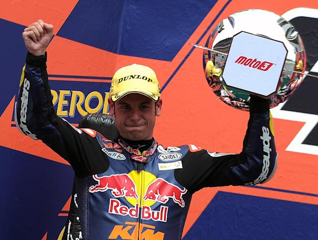 Red Bull KTM Ajo's German Sandro Cortese celebrates in the podium after the Moto3 race of the Catalunya Moto GP Grand Prix at the Catalunya racetrack in Montmelo, near Barcelona, on June 3, 2012. Blusens Avintia's Spanish Maverick Vinales won the race ahead of Red Bull KTM Ajo's German Sandro Cortese and Estrella Galicia's Portuguese Miguel Oliveira. AFP PHOTO / LLUIS GENELLUIS GENE/AFP/GettyImages