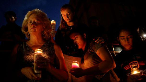PHOTO: Mourners take part in a vigil at El Paso High School after a mass shooting at a Walmart store in El Paso, Texas, Aug. 3, 2019. (Jose Luis Gonzalez/Reuters)