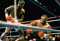 9. Buster Douglas KO10 Mike Tyson, Feb. 10, 1990 – Tyson was a 42-1 favorite to defend his IBF/WBA/WBC heavyweight titles, but he was in trouble right from the start. He had a powerful jab that he kept popping in Tyson's face. Tyson dropped Douglas in the eighth, nearly saving his title, but Douglas came back strong. He hit Tyson with an uppercut and then a series of shots, that dropped Tyson. Tyson was unable to get up and suffered his first, and most stunning, defeat. (Photo credit: Getty)