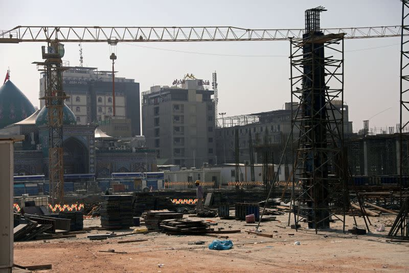 A worker stands in the construction site of the Sahn al-Aqila project, a vast expansion to the area adjacent to the Imam Hussein shrine that will be used to welcome mostly Shi'ite Muslim pilgrims in Kerbala