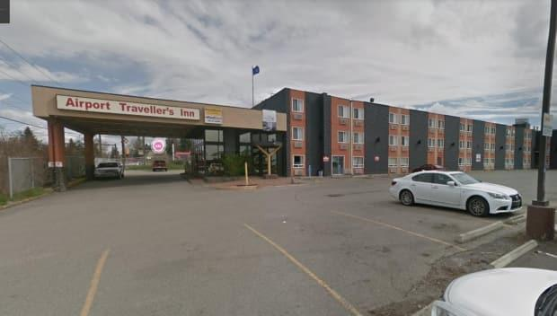 The Calgary Police Service says a woman was found a dead in a hotel room at the Airport Traveller's Inn at 1808 19th St. N.E. (Google Maps - image credit)