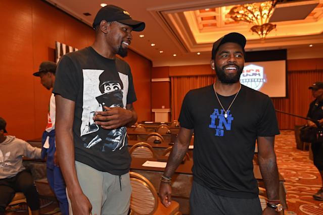 "<a class=""link rapid-noclick-resp"" href=""/nba/players/4244/"" data-ylk=""slk:Kevin Durant"">Kevin Durant</a>, left, and Kyrie Irving talk during a team meeting at the Team USA Basketball minicamp in Las Vegas on Wednesday. (Getty Images)"