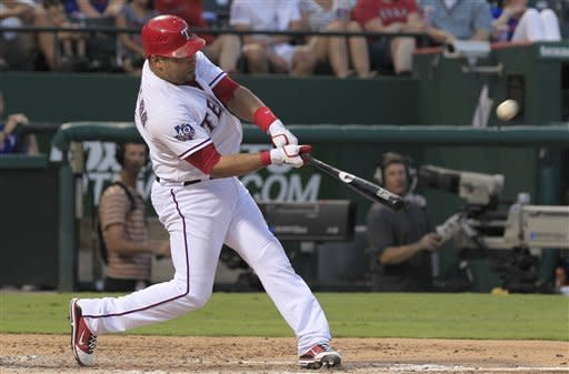 Texas Rangers Yorvit Torrealba hits a solo home run during the third inning of a baseball game against the Toronto Blue Jays Friday, May 25, 2012, in Arlington, Texas. (AP Photo/LM Otero)