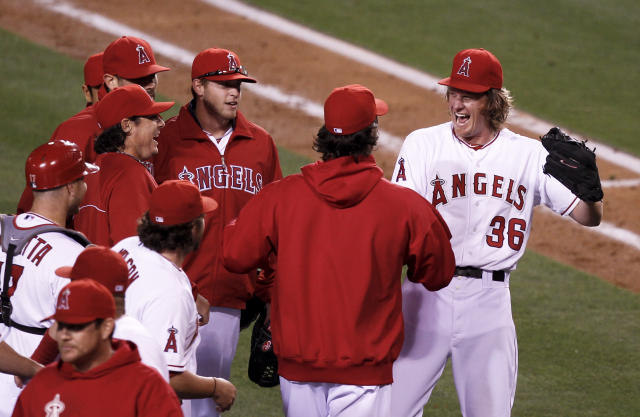 Los Angeles Angels starting pitcher Jered Weaver celebrates his no hitter against the Minnesota Twins with teammates at a baseball game in Anaheim, Calif., Wednesday, May 2, 2012. (AP Photo/Chris Carlson)