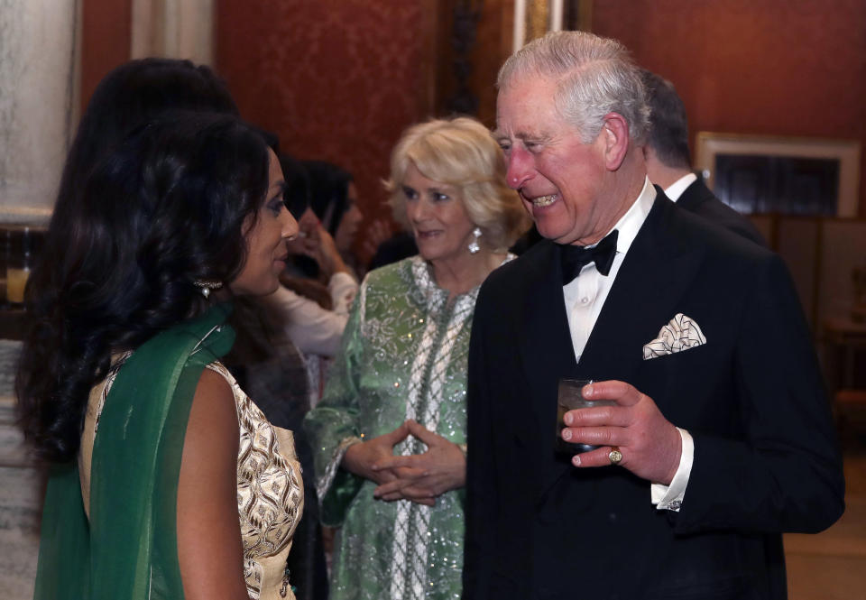 Charles and Camilla meet former cricketer Isa Guha as they host a reception for the British Asian Trust at Buckingham Palace [Photo: PA]