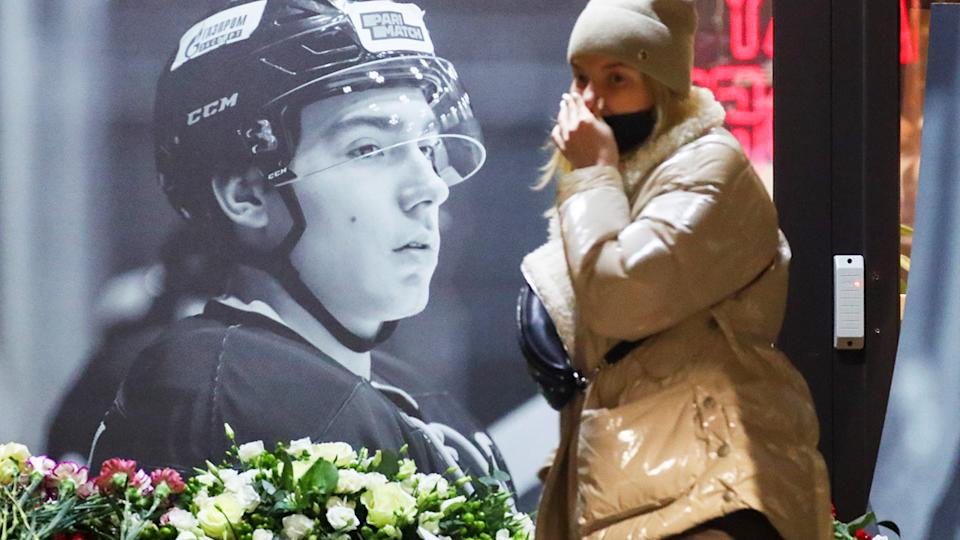 A woman, pictured here at a makeshift memorial to Timur Faizutdinov.
