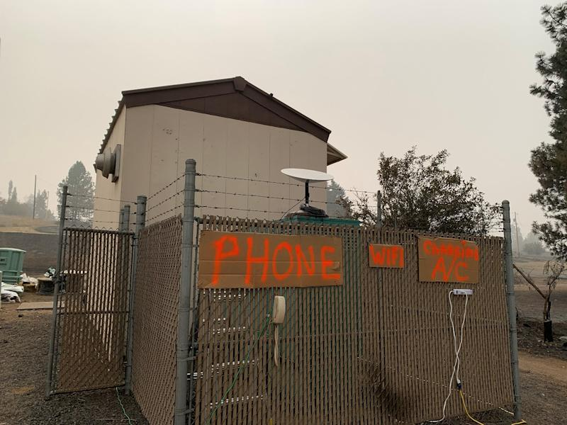 A phone, wifi hotspot, and outlet for use by people in wildfire affected areas in Washington.
