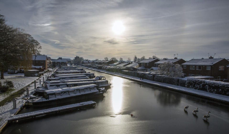 <p>Canal boats in the frozen Shropshire Union Canal at Market Drayton after Britain had its coldest night of the year with vast swathes of the country falling below freezing – with -13C (8.6F) recorded in Shropshire. (PA) </p>