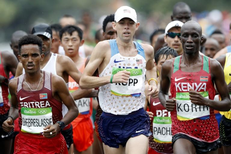 US Galen Rupp (C) and Kenya's Wesley Kipchumba Korir (R), pictured in August 2016, are just two of the men looking to dethrone last year's winner Berhanu Hayle