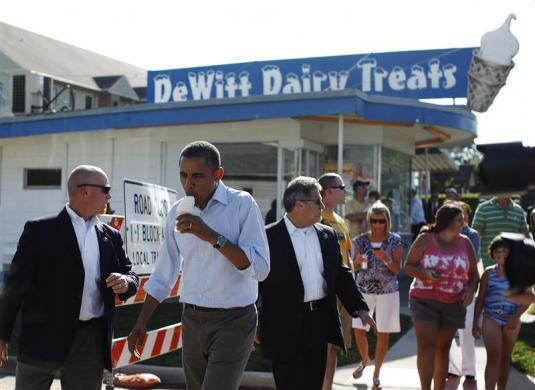 President Barack Obama eats ice cream at DeWitt Dairy Treats in DeWitt, Iowa, August 16, 2011.
