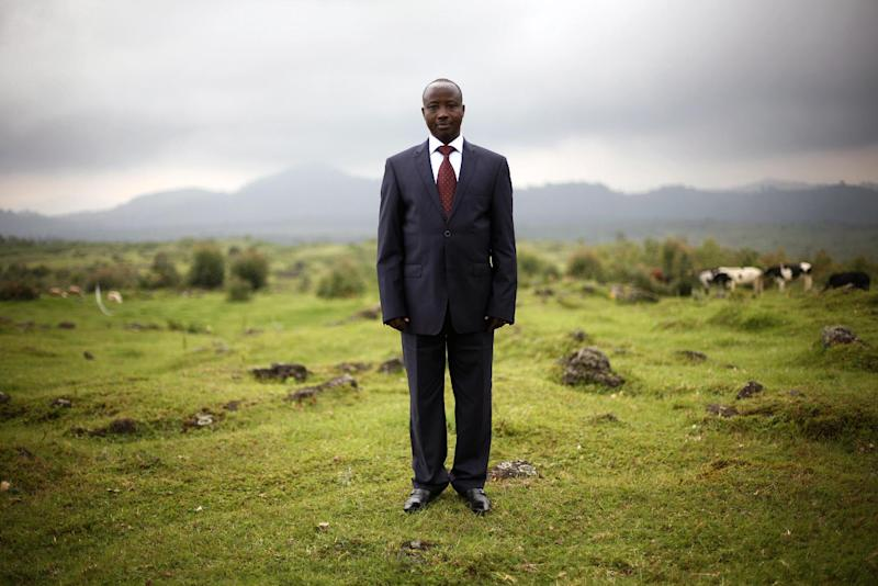 FILE - In this Dec. 5, 2012 file photo, Jean-Marie Runiga, then president of Congo's M23 rebel group, poses for a portrait at his hideout near the Congo-Uganda border town of Bunagana. A spokesman said Thursday, Feb. 28, 2013, that Runiga has been dismissed by the group's military leader over accusations that he is supporting Bosco Ntaganda, a wanted war criminal. The move has split the M23 as a new group has been formed by those who still support Runiga, including Gen. Baudoin Ngaruye, the second-ranked military leader of the group. (AP Photo/Jerome Delay, File)