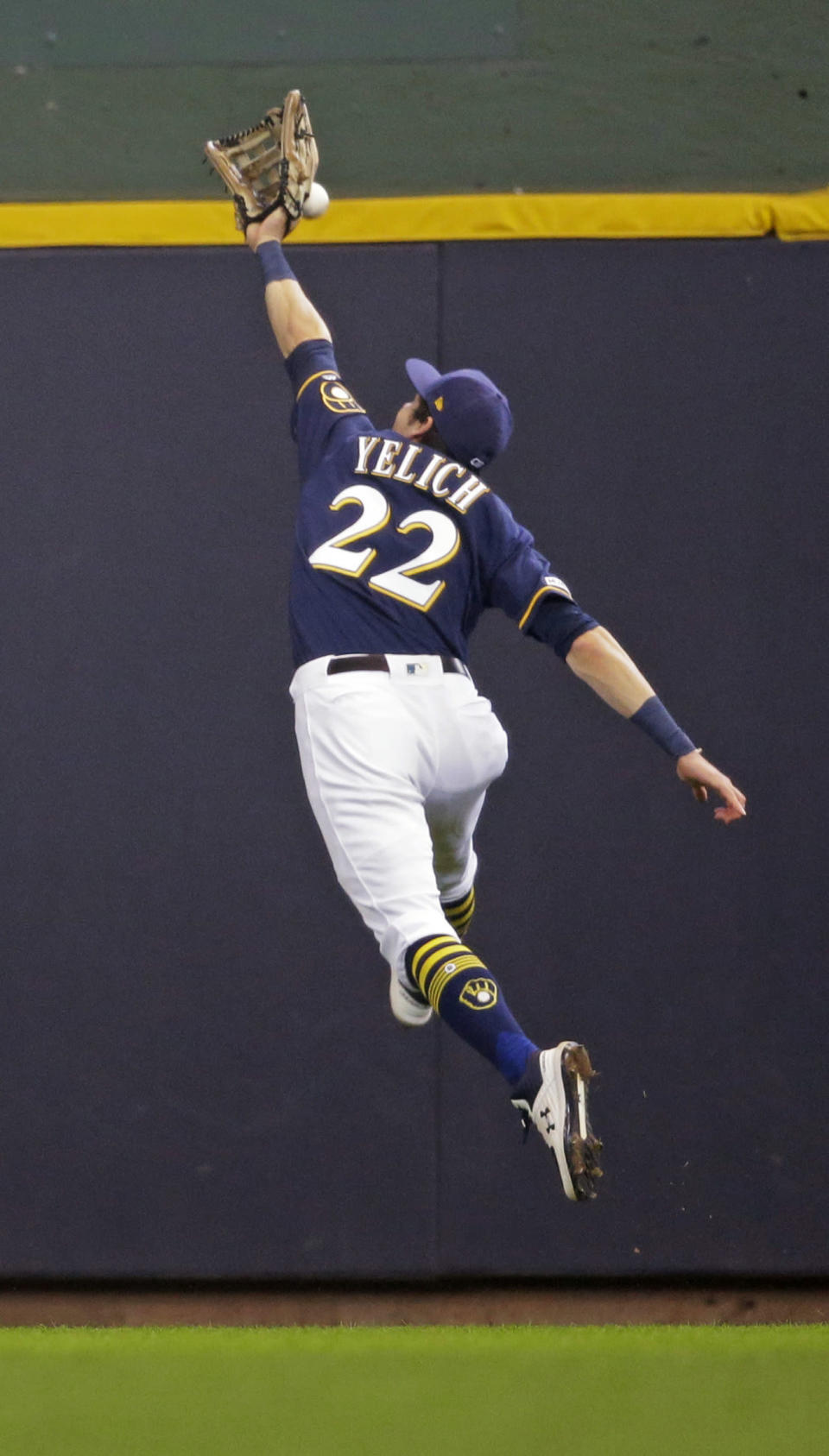 Milwaukee Brewers' Christian Yelich can't catch a triple by Minnesota Twins' Ehire Adrianza during the sixth inning of a baseball game Wednesday, Aug. 14, 2019, in Milwaukee. (AP Photo/Jeffrey Phelps)
