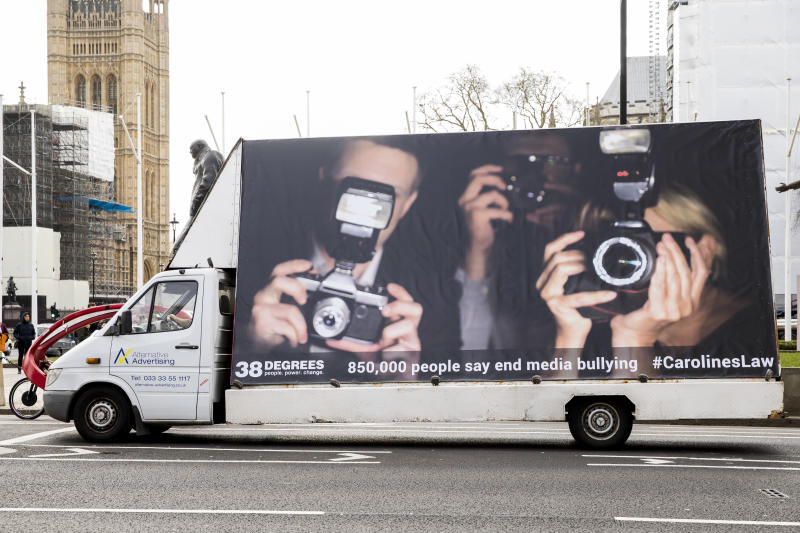 LONDON, ENGLAND - MARCH 03: A van displaying a billboard in support of Caroline's Law is driven through Parliament Square as 38 Degrees hands in a petition to the Department for Digital, Culture, Media and Sport calling for 'Caroline's Law' on March 03, 2020 in London, England. Following the death of Caroline Flack the petition addressed to Oliver Dowden, Secretary of State for Media was signed by more than 850,000 people calling for 'Caroline's Law' to end harassment and bullying by the media. (Photo by Tristan Fewings/Getty Images)