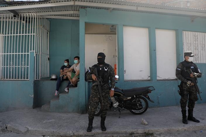 "Soldiers enforce a coronavirus-related curfew in Tegucigalpa, Honduras, in March 2020. <span class=""copyright"">(Associated Press )</span>"