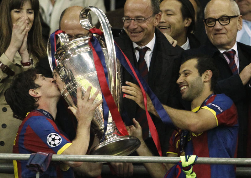 Barcelona's Lionel Messi, left, and Barcelona's Javier Mascherano celebrate with the trophy following their Champions League final soccer match against Manchester United at Wembley Stadium, London, Saturday, May 28, 2011. (AP Photo/Matt Dunham)