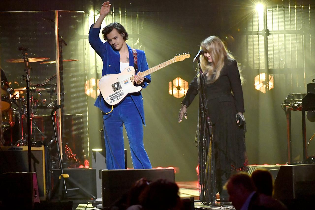"""<p>Stevie Nicks became the first woman to ever be inducted into the Rock and Roll Hall of Fame twice - first as part of Fleetwood Mac and in April 2019 as a solo artist. As her friend and colleague, Harry Styles gave a moving speech about her career and even <a href=""""https://www.popsugar.com/entertainment/Stevie-Nicks-Harry-Styles-Rock-Hall-Performance-Video-2019-45976194"""" class=""""ga-track"""" data-ga-category=""""Related"""" data-ga-label=""""https://www.popsugar.com/entertainment/Stevie-Nicks-Harry-Styles-Rock-Hall-Performance-Video-2019-45976194"""" data-ga-action=""""In-Line Links"""">performed """"Stop Draggin' My Heart Around"""" with her</a>.</p>"""