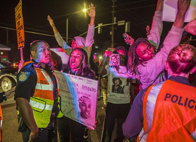 <p>Participants during a candlelight vigil in honor of Stephon Clark confront police after the event was coming to an end following a march in South Sacramento, Calif., on March 24, 2018. (Photo: Hector Amezcua/Sacramento Bee via ZUMA Wire) </p>