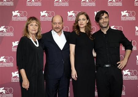 """Director Avranas poses with actors Roussinou, Pittaki and Panou during a photocall for their movie """"Miss Violence"""" at the 70th Venice Film Festival"""
