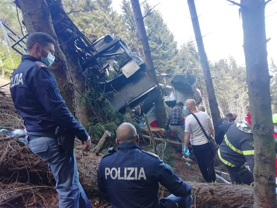 STRESA, ITALY - MAY 23: In this handout photo provided by the Italian state police, emergency workers surround the wreckage of a cable car that fell from the Stresa-Alpine-Mottarone line on May 23, 2021 in Stresa, Italy. The accident happened on a service that takes passengers from the resort town Stresa, up Mottarone mountain, in the Piedmont region. Italian news outlets reported that 11 people had been riding in the cable car before it fell, and officials said that two children were taken from the accident site to a hospital in Turin. (Handout photo by the Italian State Police via Getty Images)