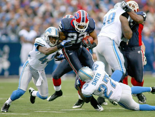ORCHARD PARK, NY - NOVEMBER 14: Fred Jackson #22 of the Buffalo Bills is tackled by Amari Spivey #42 and Alphonso Smith #27 of the Detroit Lions at Ralph Wilson Stadium on November 14, 2010 in Orchard Park, New York. (Photo by Rick Stewart/Getty Images)