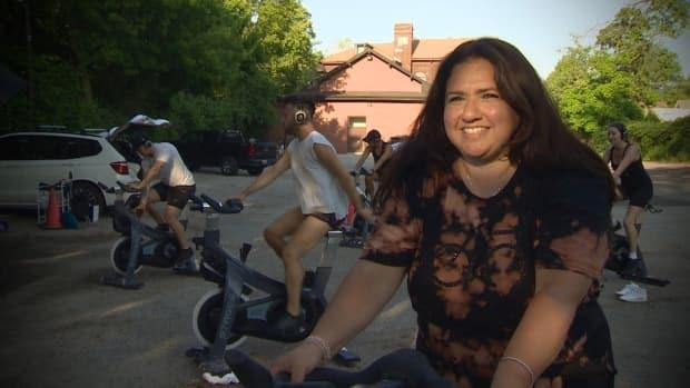 Debrah Menashy, owner of Loft Cycle Club Inc. in Toronto, will be starting outdoor spin classes as the province moves into the initial phase of its reopening plan on Friday, three days ahead of schedule.   (CBC - image credit)