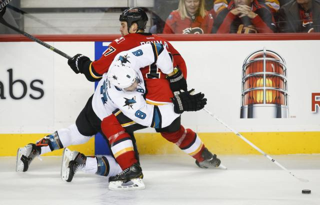 San Jose Sharks' Joe Pavelski, left, tries to get past Calgary Flames' Lance Bouma during the second period of an NHL hockey game Tuesday, Nov. 12, 2013, in Calgary, Alberta. (AP Photo/The Canadian Press, Jeff McIntosh)