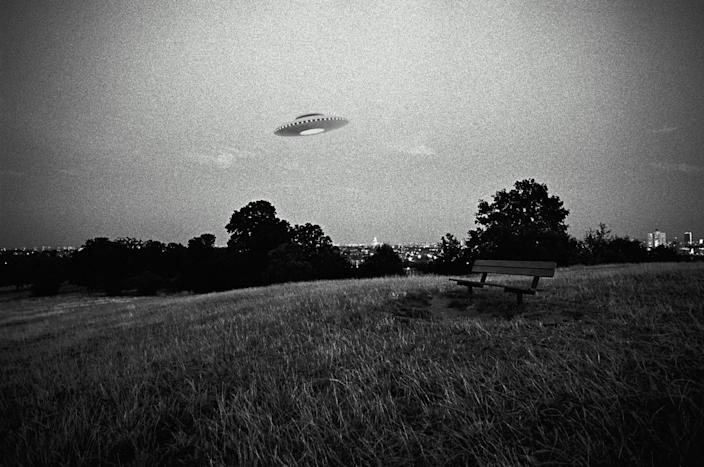 Do aliens exist? A UFO flies above a field in this digital composite. (Photo: Getty Images)