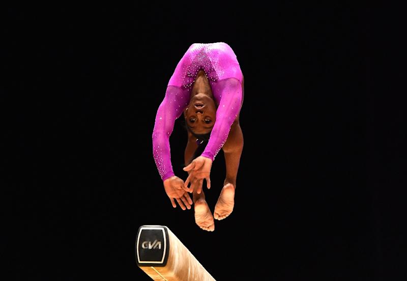 Simone Biles defends her balance beam title at the world gymnastics championships on Sunday to claim a ninth world gold (AFP Photo/Ben Stansall, Ben Stansall)