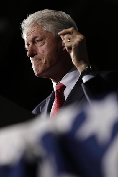 Former President Bill Clinton gestures while speaking at a President Barack Obama campaign rally at the Covelli Centre, Monday, Oct. 29, 2012, in Youngstown, Ohio. (AP Photo/Matt Rourke)