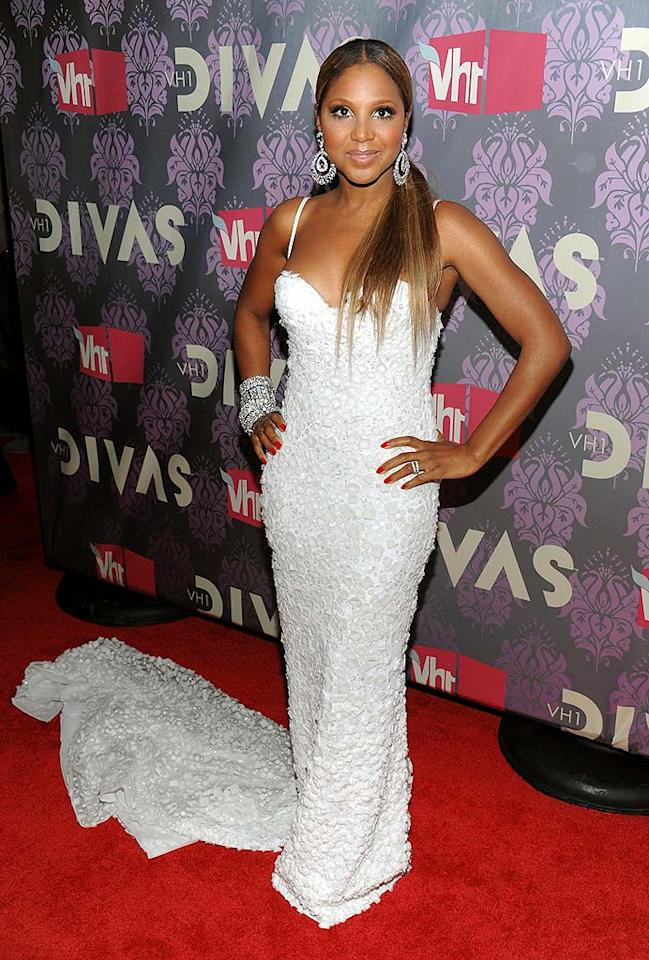 "Toni Braxton looked as if she were ready to walk down the aisle in a bright white gown and train, which she accessorized with blingy bangles. Dimitrios Kambouris/<a href=""http://www.wireimage.com"" target=""new"">WireImage.com</a> - September 17, 2009"
