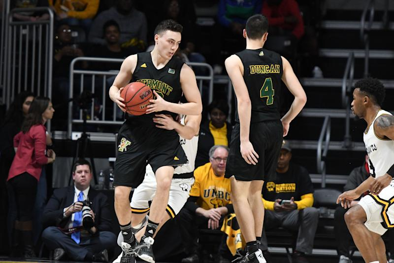 CATONSVILLE, MD - FEBRUARY 21: Ernie Duncan #20 of the Vermont Catamounts dribbles around Robin Duncan #4 during a college basketball game against the UMBC Retrievers at the Event Center on February 21, 2019 in Catsonsville, Maryland. (Photo by Mitchell Layton/Getty Images)