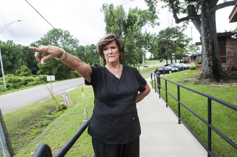 Abortion clinic owner Gloria Gray stands on the exit ramp she was legally required to build. She says it cost her about $150, 000 to comply with a state regulation about clinic exits. (Chloe Angyal for HuffPost)