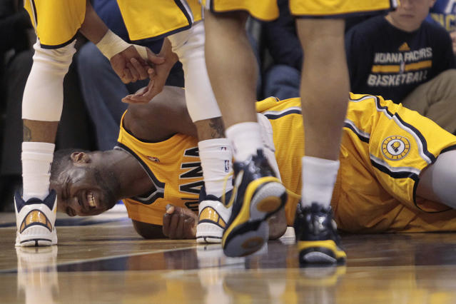 Indiana Pacers center Roy Hibbert reacts to being fouled by Detroit Pistons forward Charlie Villanueva, not pictured, during the first half of an NBA basketball game in Indianapolis, Wednesday, April 2, 2014. Hibbert's return to the game was listed as questionable due to a sore hip. (AP Photo/AJ Mast)