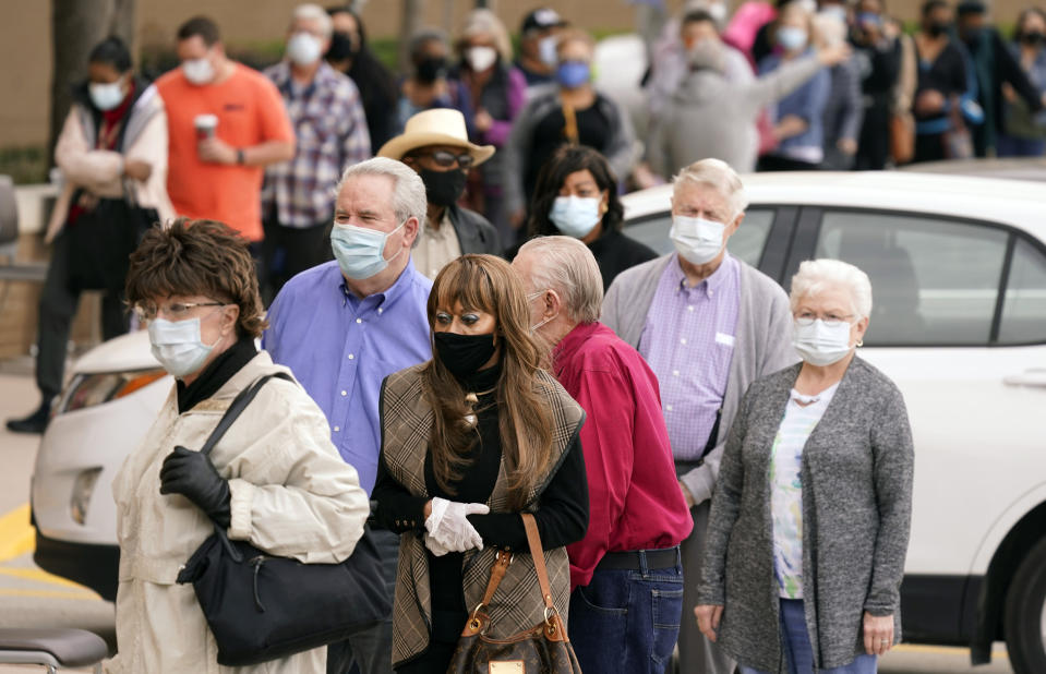 People wait in line to receive a COVID-19 vaccination at Methodist Hospital in the Oak Cliff section of Dallas, Thursday, Feb. 4, 2021. (AP Photo/LM Otero)