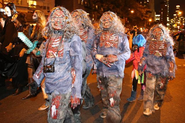 <p>People wear creepy costumes to the 44th annual Village Halloween Parade in New York City on Oct. 31, 2017. (Photo: Gordon Donovan/Yahoo News) </p>