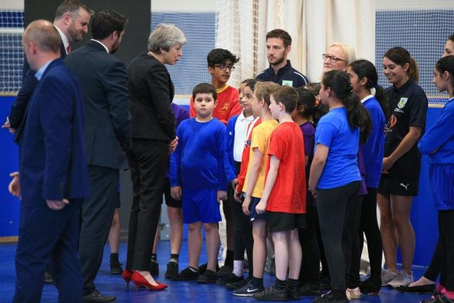Theresa May talks to children