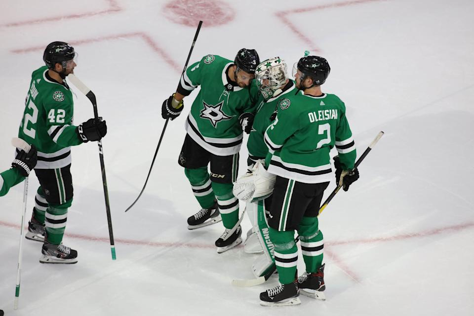 The Stars' Taylor Fedun (42), Andrej Sekera (5), Anton Khudobin (35) and Jamie Oleksiak (2) celebrate the 5-4 victory against the Avalanche.
