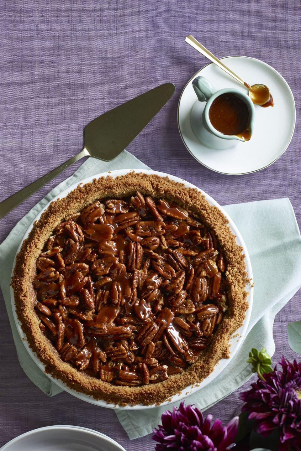 "<p>This chocolaty, nutty pie is sticky-sweet in the best way. </p><p><strong><em><a href=""https://www.womansday.com/food-recipes/food-drinks/recipes/a60505/salted-caramel-pecan-and-chocolate-pie-recipe/"" rel=""nofollow noopener"" target=""_blank"" data-ylk=""slk:Get the Salted Caramel Pecan and Chocolate Pie recipe."" class=""link rapid-noclick-resp"">Get the Salted Caramel Pecan and Chocolate Pie recipe. </a></em></strong></p><p><br></p>"