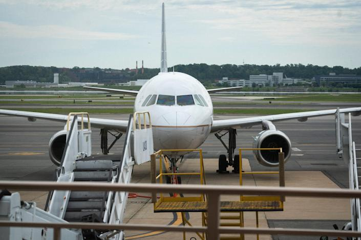 A United Airlines jet sits at the gate at Ronald Reagan Washington National Airport. United said it is starting to add back flights lost to fears of the coronavirus pandemic.