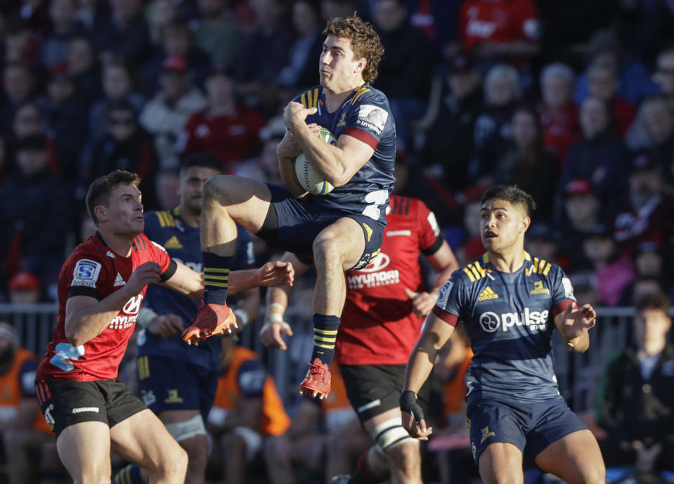 Highlanders Josh McKay leaps in the air to catch the ball during the Super Rugby Aotearoa rugby game between the Crusaders and the Highlanders in Christchurch, New Zealand, Sunday, Aug. 9, 2020. (AP Photo/Mark Baker)