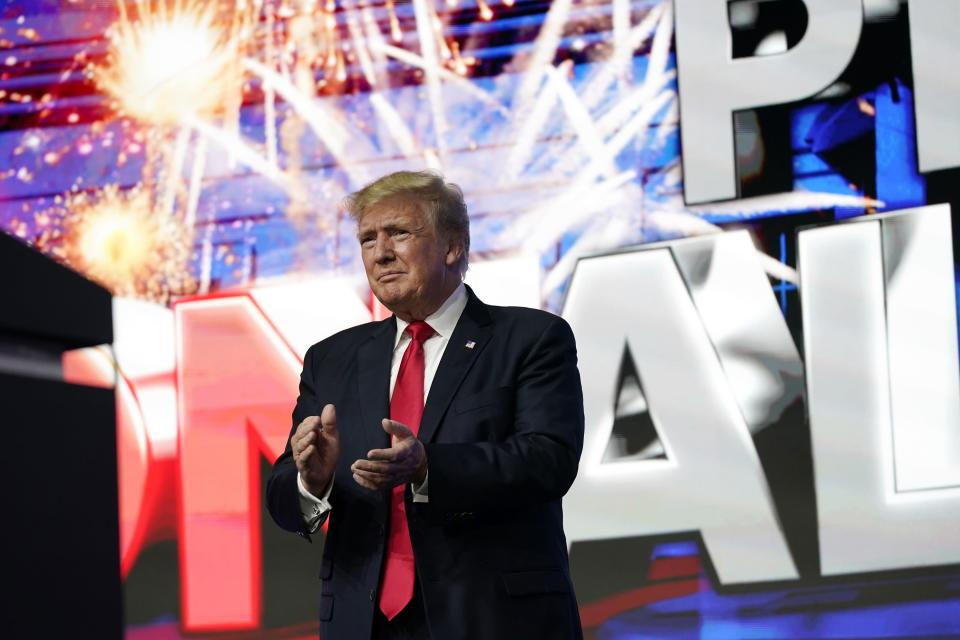 Former President Donald Trump applauds supporters prior to speaking at a Turning Point Action gathering, Saturday, July 24, 2021, in Phoenix. (AP Photo/Ross D. Franklin)