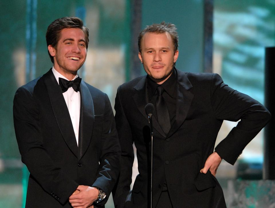 """Jake Gyllenhaal and Heath Ledger introduce a clip of """"Brokeback Mountain"""", nominee for Outstanding Performance by a Cast in a Motion Picture  10617_mc0278.jpg (Photo by M. Caulfield/WireImage for Turner)"""