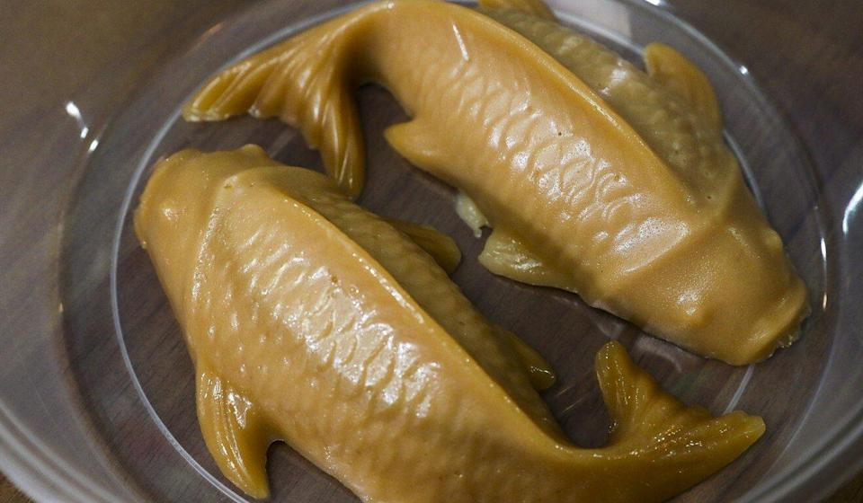 Fish-shaped sticky rice cakes offered by Happy Together Hotpot as an accompaniment to its poon choi. Photo: Edmond So