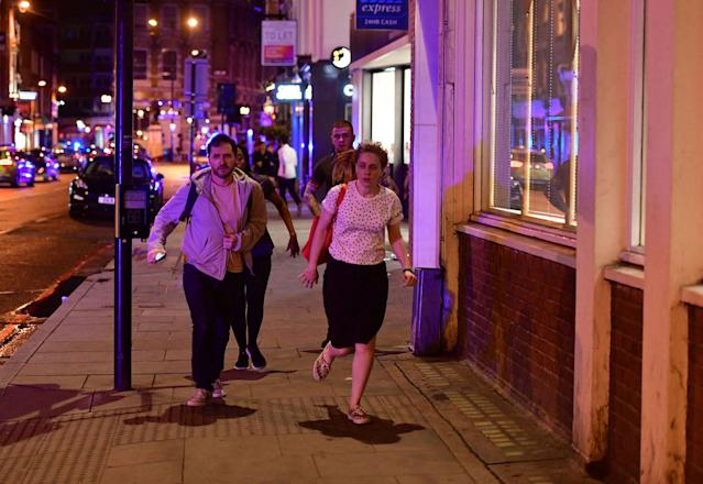"<p>People run down Borough High Street as police are dealing with a ""major incident"" at London Bridge in London, Saturday, June 3, 2017. London incident. (Dominic Lipinski/PA via AP) </p>"