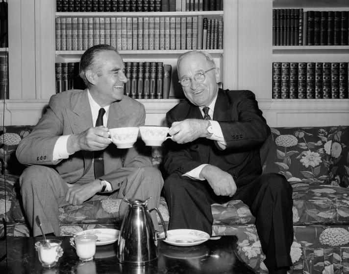 """Former President Harry S. Truman and New York's Governor Averell Harriman """"toast"""" each other over coffee at Harriman's New York City home, July 5, 1956. The former chief executive and the candidate for the Democratic presidential nomination walked to meet each other during the morning and then strolled to Harriman's East Side residence for breakfast. Truman again professed his intention to remain neutral in the Democratic campaign. (AP Photo/Anthony Camerano)"""